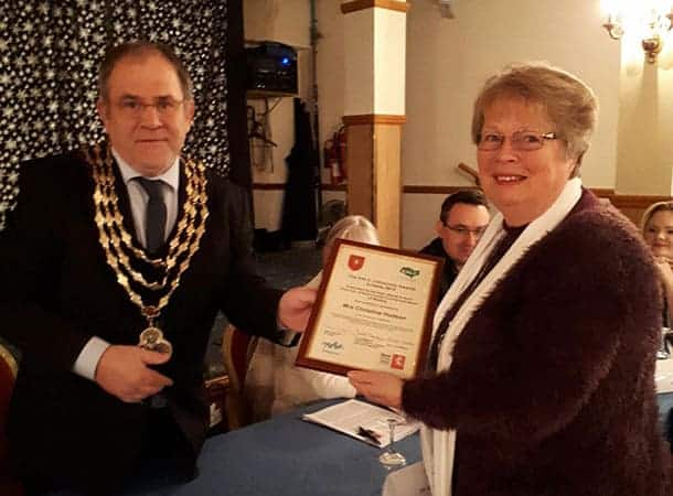 The mayor, Cllr Ball presenting the award to Christine Hudson
