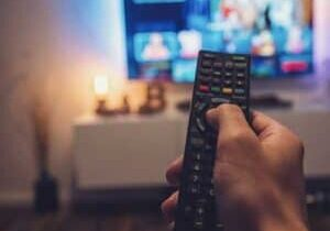Male-hand-holding-TV-remote-control