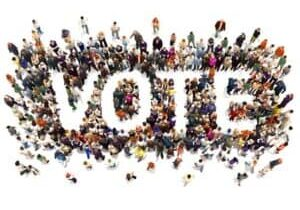 people-standing-together-making-the-word-vote